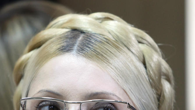FILE - In this Tuesday, Oct. 11, 2011  file photo, former Ukrainian Prime Minister Yulia Tymoshenko is pictured during her trial, at the Pecherskiy District Court in Kiev, Ukraine.  Lawyers for Yulia Tymoshenko, the Ukrainian opposition leader who has been jailed and convicted of abusing her office, are appealing before the European Court of Human Rights, with the hearing on Tuesday Aug. 28, 2012, it comes one day before a court in Ukraine is expected to rule on her appeal against her conviction, which she says is politically motivated. Tymoshenko was an architect of Ukraine's 2004 Orange Revolution. She was sentenced to seven years in prison in October 2011 over allegations involving a gas contract negotiated while she was prime minister.  (AP Photo/Efrem Lukatsky, file)
