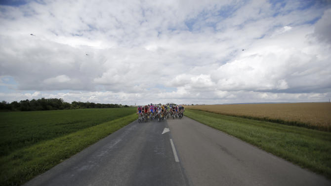 The pack rides during the sixth stage of the Tour de France cycling race over 207.5 kilometers (129 miles) with start in Epernay and finish in Metz, France, Friday July 6, 2012. (AP Photo/Christophe Ena)