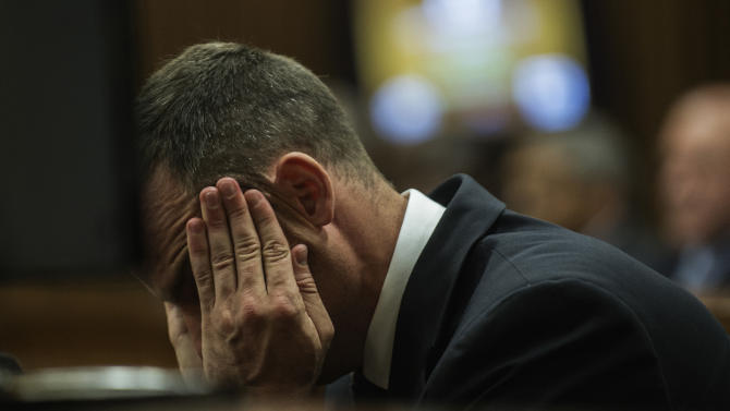 Oscar Pistorius cradles his head in his hands as he listens to evidence during his murder trial in Pretoria, South Africa, Thursday, May 8, 2014. Pistorius is charged with the shooting death of his girlfriend Reeva Steenkamp on Valentine's Day in 2013. (AP Photo/Gianluigi Guercia, Pool)