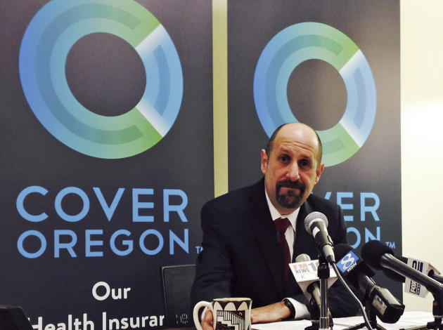 FILE - This Dec. 10, 2013, file photo shows Dr. Bruce Goldberg, acting head of Oregon's troubled health insurance exchange, at a news conference at Cover Oregon headquarters in Durham, Ore. More t