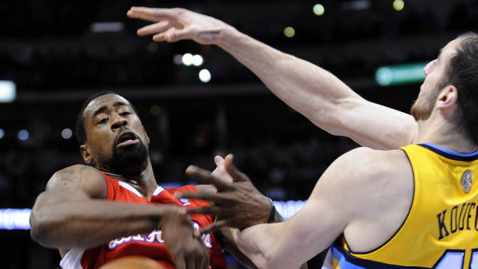 Los Angeles Clippers center DeAndre Jordan (6) loses the ball against Denver Nuggets center Kosta Koufos (41) during the first quarter of an NBA basketball game, Tuesday, Jan. 1, 2013, in Denver. (AP Photo/Jack Dempsey)