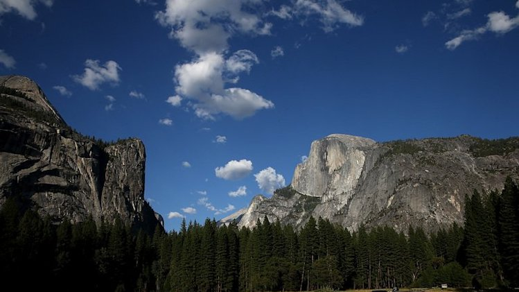 A view of Half Dome and the Yosemite Valley on August 28, 2013 in Yosemite Nationall Park, California