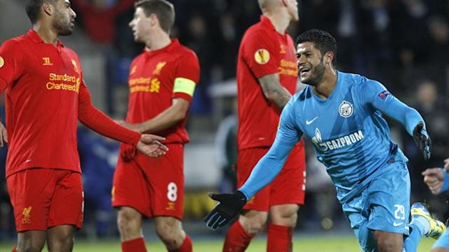 Zenit St. Petersburg's Hulk (R) celebrates his goal during the Europa League soccer match against Liverpool at the Petrovsky stadium in St. Petersburg, February 14, 2013. REUTERS