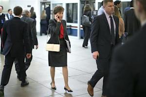 U.S. Senataor Collins talks on a mobile phone as she arrives for the weekly Republican caucus luncheon at the U.S. Capitol in Washington
