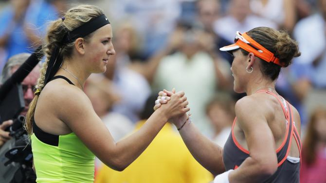Victoria Azarenka, of Belarus, left, shakes hands with Samantha Stosur, of Australia, after winning their quarterfinals match of the 2012 US Open tennis tournament,  Tuesday, Sept. 4, 2012, in New York. (AP Photo/Mike Groll)