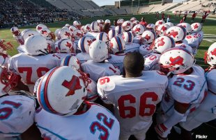 The Dallas Skyline football huddle