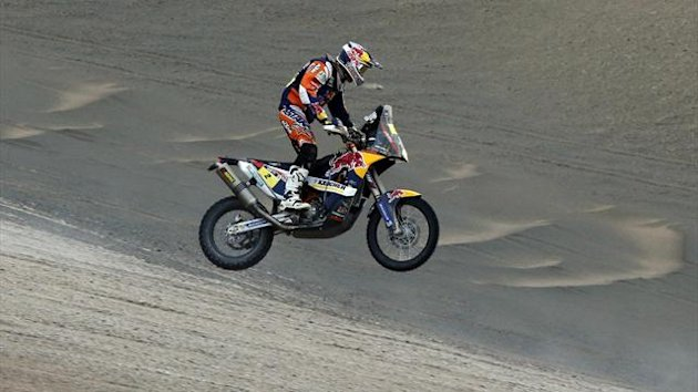 Spain's Marc Coma jumps as he rides his KTM motorcycle during the 10th stage of the Dakar Rally (Reuters)