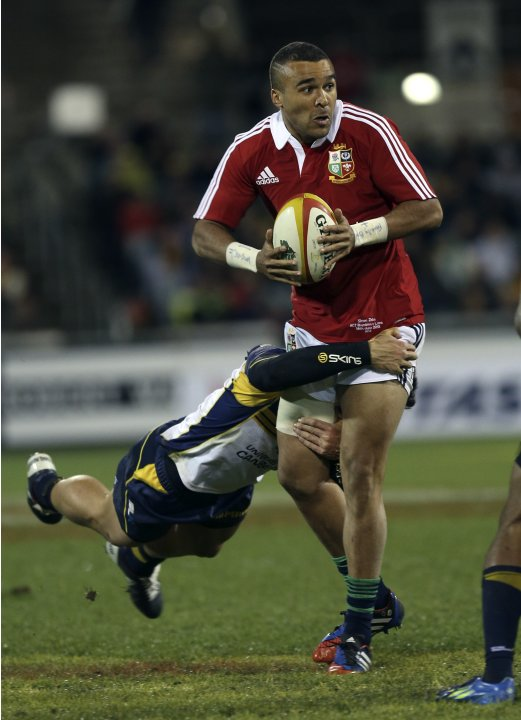 British and Irish Lions player Zebo prepares to pass the ball during their rugby union game against the ACT Brumbies at Canberra stadium