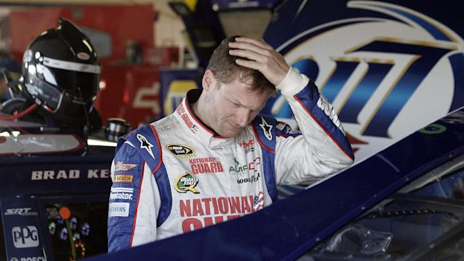 Dale Earnhardt Jr., looks at his car during practice for Sunday's NASCAR Sprint Cup Series auto race at Michigan International Speedway Saturday, Aug. 18, 2012, in Brooklyn, Mich.  (AP Photo/Luke Brodbeck)