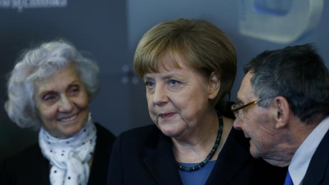 German Chancellor Merkel and Auschwitz survivors Fahidi and Turski attend the opening event for the international remembrance of the 70th anniversary of the Liberation of Auschwitz in Berlin
