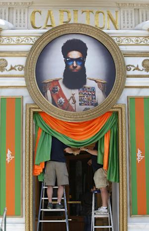 Workers make the finishing touches on a display for The Dictator during final preparations for the 65th international film festival, in Cannes, southern France, Tuesday, May 15, 2012. The Cannes film festival runs from May 16 to May 27, 2012. (AP Photo/Lionel Cirroneau)