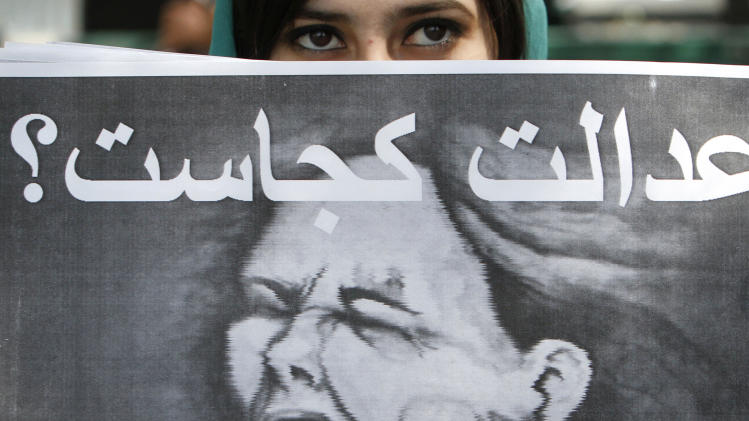 "An Afghan woman holds up a poster during a protest in Kabul, Afghanistan, Saturday, April 14, 2012. A group of Afghan women protested against domestic violence. The poster reads: ""Where is justice"". (AP Photo/Musadeq Sadeq)"