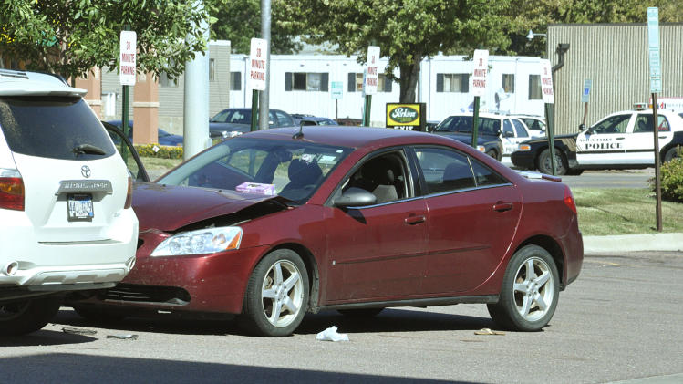 Police in Sioux Falls, S.D., responding to a car accident in the parking lot of the Cost Cutters hair salon found a woman, Amanda Connors, dead inside the car from a gunshot wound, Tuesday, Sept. 11, 2012. Police say the gunman kidnapped his two kids from a babysitter at gunpoint, shot Connors, a Cost Cutters employee, and then holed up inside the salon. Officers later found the man inside dead from an apparent self-inflicted gunshot wound. (AP Photo/Dirk Lammers)