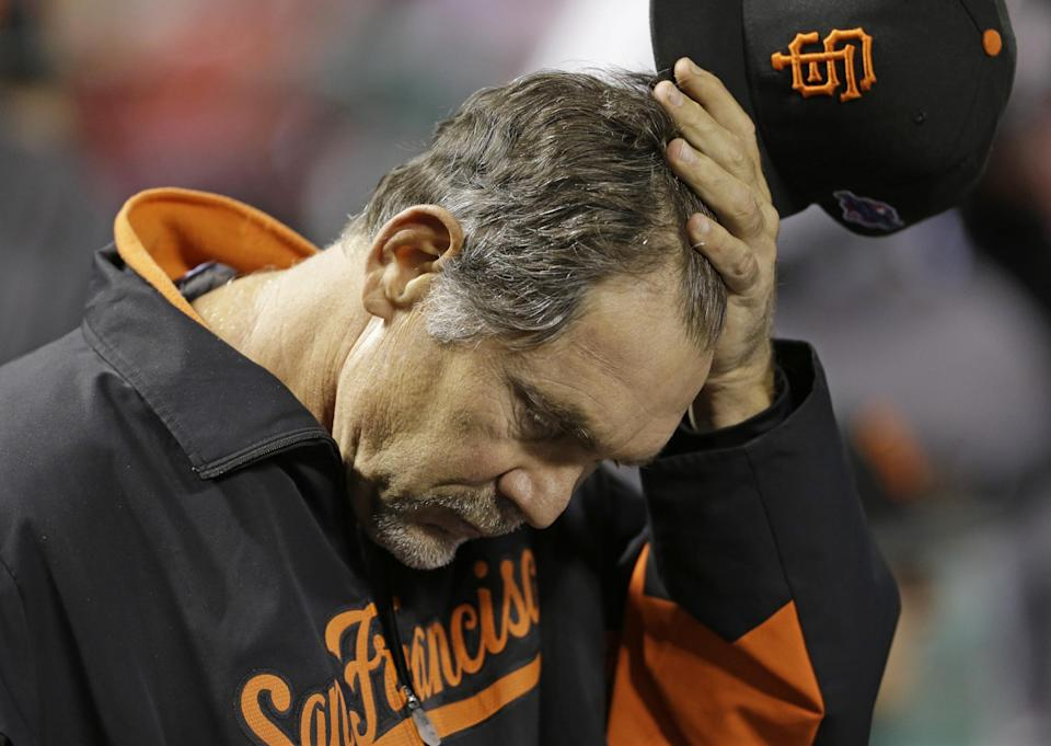 San Francisco Giants manager Bruce Bochy scratches his head in the dugout during the seventh inning of Game 4 of baseball's National League championship series against the St. Louis Cardinals Thursday, Oct. 18, 2012, in St. Louis. (AP Photo/Jeff Roberson)