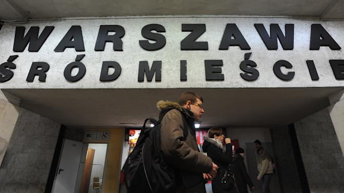 People walk under a board with the name of a train station with several Polish diacritical marks, in Warsaw, Poland, Thursday, Feb. 21, 2013. Polish language experts have launched a campaign, as part of the UNESCO International Mother Language Day, to preserve the challenging system of its diacritical marks, saying the tails, dots and strokes are becoming obsolete under the pressure of IT and speed. The name of the station reads Warsaw Downtown. (AP Photo/Alik Keplicz)