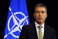NATO Secretary General Anders Fogh Rasmussen has expressed the Western alliance's determination to push ahead with building a missile defense system in Europe