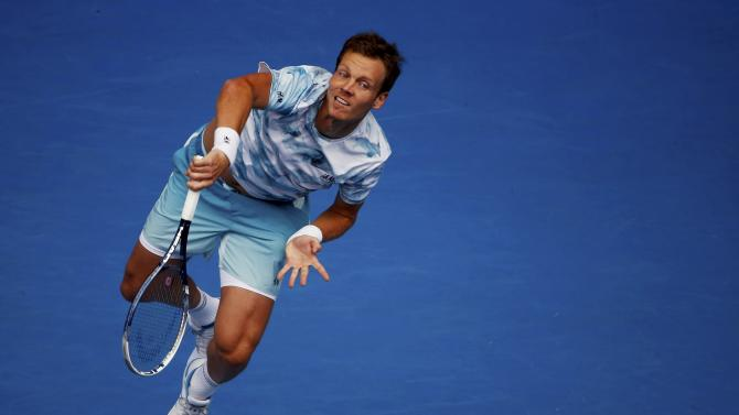 Berdych of the Czech Republic serves to Nadal of Spain during their men's singles quarter-final match at the Australian Open 2015 tennis tournament in Melbourne