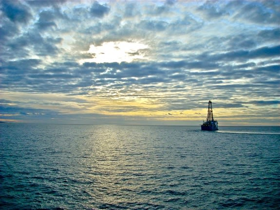 """The Joides Resolution heads to sea from the Azores to drill sediments on IODP Expedition 339 offshore Peru. Most of the Earth's organic carbon is stored in seafloor sediments.""  Photo by Joseph Russell/University of Delaware"