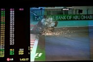 A giant screen shows Nico Rosberg (above) crashing his Mercedes into Narain Karthikeyan&#39;s Hispania during the Abu Dhabi Grand Prix. Rosberg was fortunate to walk away unscathed after the massive crash