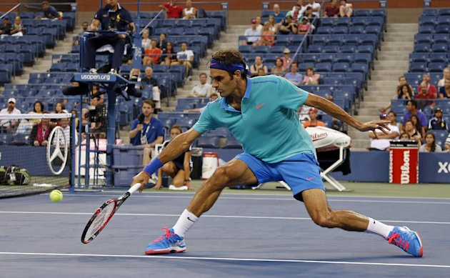 Roger Federer caught fire when play resumed after a rain delay, even though there weren't many yet in the stadium to witness it. (AP Photo/Elise Amendola)