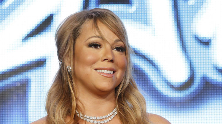 """Mariah Carey from """"American Idol"""" attend the Fox Winter TCA Tour at the Langham Huntington Hotel on Tuesday, Jan. 8, 2013, in Pasadena, Calif. (Photo by Todd Williamson/Invision/AP)"""