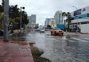 Flooding at Alton Road and 10th Street is seen in Miami Beach