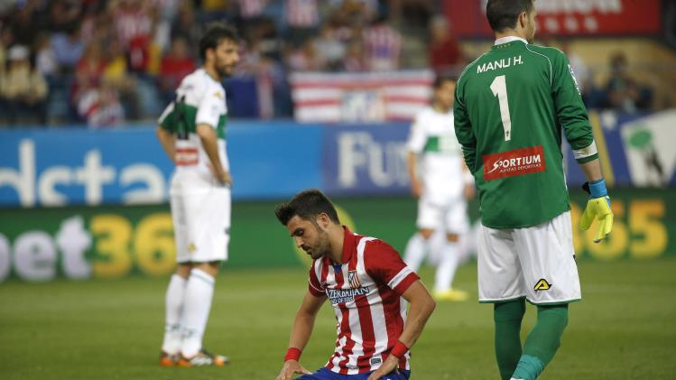 Atletico Madrid's Villa reacts after a missed opportunity during their Spanish first division soccer match Against Elche at Vicente Calderon stadium in Madrid