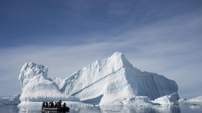 FILE - In this Dec. 1, 2009 file photo provided by Aurora Expeditions, an inflatable boat carries tourists past an iceberg along the Antarctic Peninsula. The U.S. government shutdown is threatening a long-awaited deal to create the world's largest marine sanctuary in Antarctica. Americans are among the biggest supporters of the proposal, but they might not make it to the negotiating table. On Wednesday, Oct. 16, 2013, U.S. Secretary of State John Kerry joined his counterparts from other nations in calling for the sanctuary to proceed. But the U.S. had apparently already suspended travel plans for its delegation. If they don't make it, the proposal probably will be put on hold until next year at least. (AP Photo/Aurora Expeditions, Andrew Halsall, File) EDITORIAL USE ONLY