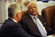 Yemeni Prime Minister Mohammed Basindawa (R) talks to British State Minister for International Development Alan Duncan during the international donor meeting for Yemen, in Riyadh. Yemen is undergoing a political transition after a year-long uprising unseated veteran leader Ali Abdullah Saleh and left the economy of the Arabian peninsula&#39;s poorest country in shambles