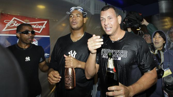 New York Yankees' Alex Rodriguez, right, and Ivan Nova, center, celebrates in the clubhouse with teammates after Game 5 of the American League division baseball series against the Baltimore Orioles, Friday, Oct. 12, 2012, in New York. The Yankees won the game 3-1 and advanced to the AL championship. (AP Photo/Kathy Willens)