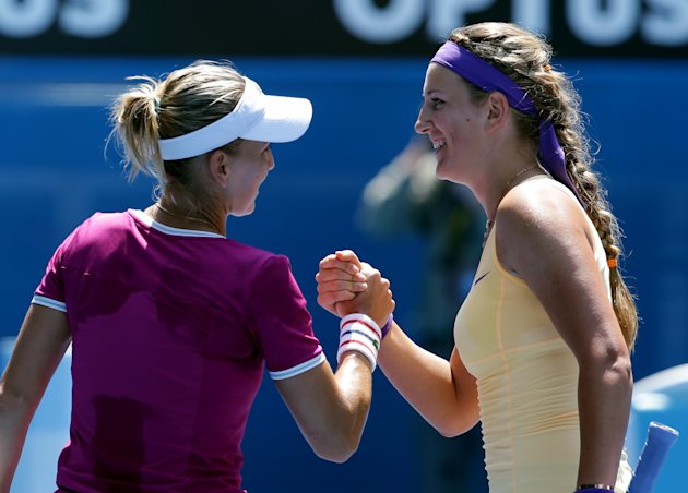 Victoria Azarenka of Belarus, right, is congratulated by Russia's Elena Vesnina after Azarenka won their fourth round match at the Australian Open tennis championship in Melbourne, Australia, Monday, Jan. 21, 2013. (AP Photo/Aaron Favila)