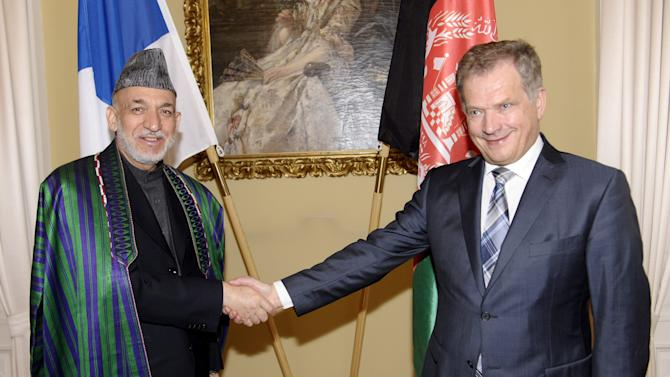 Finnish President Sauli Niinisto, right, and Afghan President Hamid Karzai shake hands in Helsinki, Finland Monday, April 29, 2013. Afghan President Karzai arrived to Finland for a working visit Monday. (AP Photo/Lehtikuva,  Heikki Saukkomaa) FINLAND OUT, NO THIRD PARTY SALES