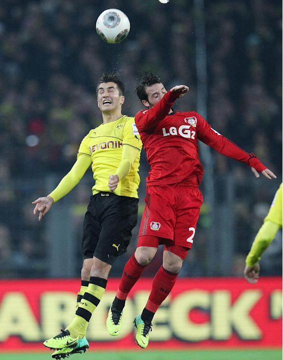 Dortmund's Nuri Sahin, left, and Leverkusen's Omer Toprak of Turkey jump for the ball during the German first division Bundesliga soccer match between Borussia Dortmund and Bayer Leverkusen in