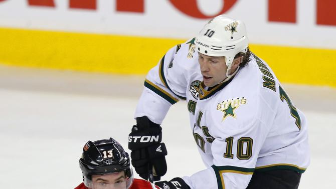 Calgary Flames' Cammalleri is knocked to the ice by Dallas Stars' Morrow during their NHL hockey game in Calgary.