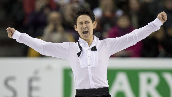 Denis Ten, from Kazakhstan, celebrates after his free skate program in the men's competition at the World Figure Skating Championships Friday, March 15, 2013 in London, Ontario. Ten won the silver medal. (AP Photo/The Canadian Press, Paul Chiasson)