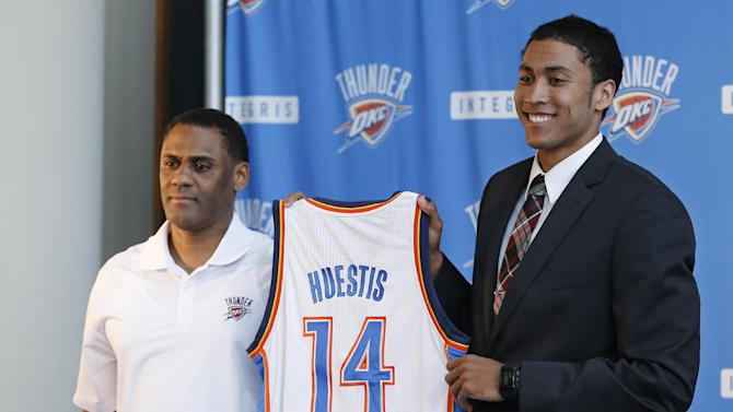 Oklahoma City Thunder forward Josh Huestis, right, and Troy Weaver, left, Thunder vice president and assistant general manager, hold a basketball jersey as Huestis is introduced during a news conference in Oklahoma City, Friday, June 27, 2014
