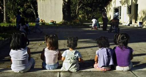 "Illustration. Children sit in the yard of the ""Messengers of Peace"" home for abandoned HIV-positive children in San Martin, El Salvador, November 2007. Researchers say they have for the first time, cured a baby born with HIV -- a development that could help improve treatment of babies infected at birth"
