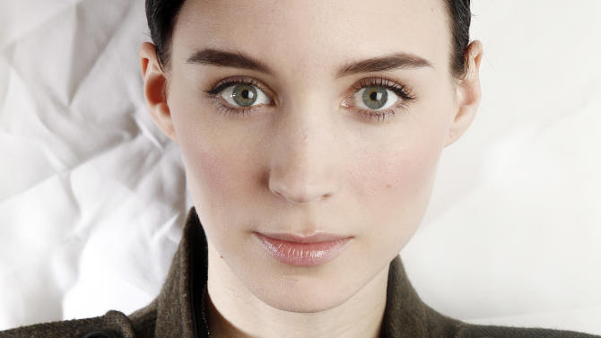 "FILE-  In this Saturday, Dec. 17, 2011 file photo, actress Rooney Mara poses for a portrait at the Crosby St. Hotel  in New York. It took Mara two and a half months and five screen tests to land the sought-after role of Lisbeth Salander, the fierce heroine in ""The Girl With the Dragon Tattoo.""  (AP Photo/Carlo Allegri, FILE)"