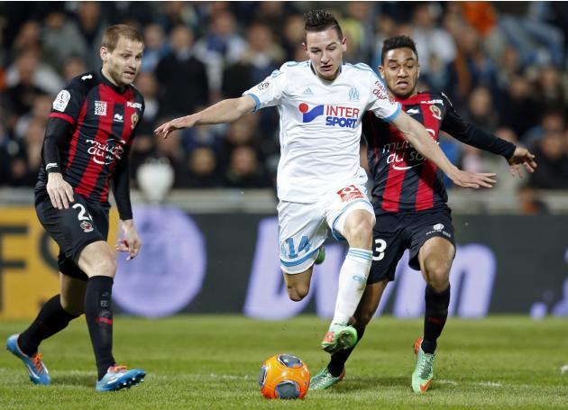 Olympique Marseille's Thauvin challenges Nice's Bodmer and Amavi during their French Ligue 1 soccer match in Marseille