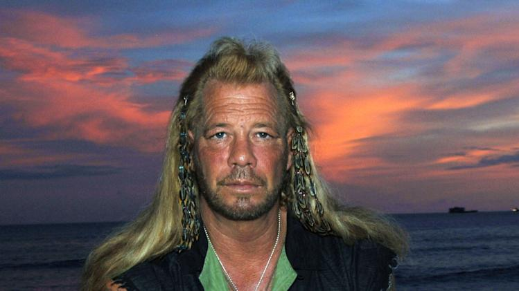 "FILE - This Jan. 10, 2006 file photo shows bounty hunter Duane ""Dog"" Chapman star of the Hawaii-based reality show, ""Dog the Bounty Hunter,"" on Waikiki Beach, in Honolulu. Chapman has his bags packed for London, but a murder conviction from the late 1970s is keeping him out of the United Kingdom. He was to appear on another reality show, ""Celebrity Big Brother,"" but he has been denied a visa. ""It's something that follows you the rest of your life, no matter who you become or who you are,"" Chapman, 59, said Monday from Honolulu, where he lives. ""I'm not proud of it."" (AP Photo/Lucy Pemoni, file)"