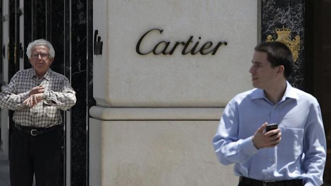Men stand outside the Cartier store on Rodeo Drive in Beverly Hills