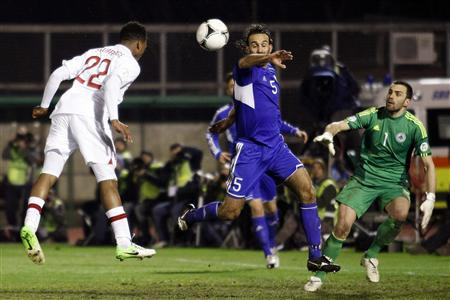 England's Sturridge heads the ball to score against San Marino during their 2014 World Cup qualifying soccer match in San Marino