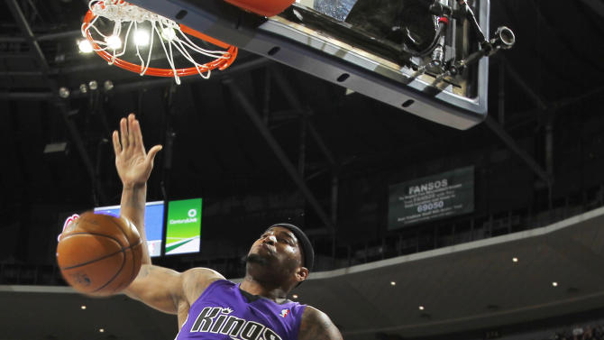 Sacramento Kings center DeMarcus Cousins dunks in front of Denver Nuggets forward Kenneth Faried during the first quarter of an NBA basketball game in Denver on Saturday, March 23, 2013. (AP Photo/David Zalubowski)
