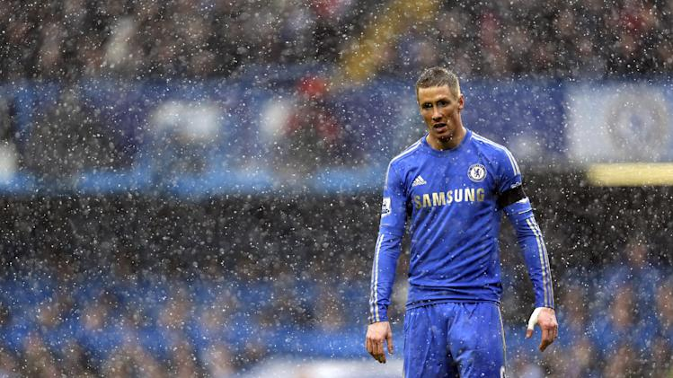 Chelsea's Fernando Torres, of Spain, stands in the snow during a Premier League soccer match against Arsenal, at Stamford Bridge ground in London, Sunday, Jan. 20, 2013. Chelsea won the match 2-1. (AP Photo/Lefteris Pitarakis)