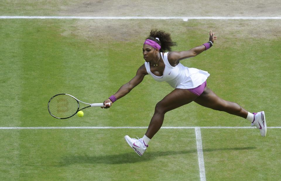 Serena Williams of the United States plays a shot to Victoria Azarenka of Belarus during a women's semifinals match at the All England Lawn Tennis Championships at Wimbledon, England, Thursday, July 5, 2012. (AP Photo/Gerry Penny, Pool)