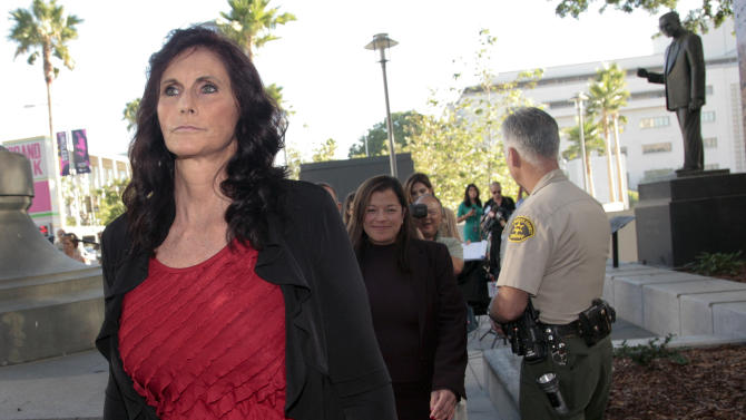 """FILE- In this Sept. 20, 2012 file photo, Cindy Lee Garcia, one of the actresses in """"Innocence of Muslims,"""" left, arrives for a hearing at Los Angeles Superior Court in Los Angeles. Garcia has lost another legal bid to have the trailer for the film taken down from YouTube. A federal judge in Los Angeles denied a motion for injunction by Garcia on Friday, Nov. 30, 2012. It wasn't immediately known whether Garcia's attorneys would file an appeal. (AP Photo/Jason Redmond, File)"""