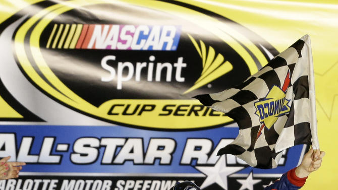 Jimmie Johnson celebrates in victory lane after winning the NASCAR Sprint Cup Series All-Star auto race at Charlotte Motor Speedway in Concord, N.C., Sunday, May 19, 2013. (AP Photo/Gerry Broome)