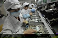 Chinese workers at the Foxconn factory in Shenzhen, southern China. Apple co-founder Steve Wozniak has predicted &quot;horrible problems&quot; in the coming years as cloud-based computing takes hold
