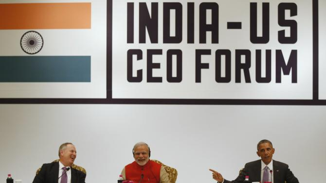 Honeywell CEO Cote and India's Prime Minister Modi laugh at a remark by U.S. President Obama during a CEO Roundtable and Forum at the India U.S. Business Summit in New Delhi