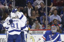 New York Rangers goalie Henrik Lundqvist (30) checks the scoreboard as the Tampa Bay Lightning celebrate a second period goal during Game 5 of the Eastern Conference final during the NHL hockey Stanley Cup playoffs, Sunday, May 24, 2015, in New York. (AP Photo/Frank Franklin)